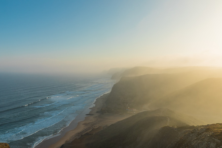 Portugal cliffs on the Atlantic ocean on a summer day. Landscape