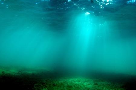 Photo pour Light Beams Under Water  - image libre de droit