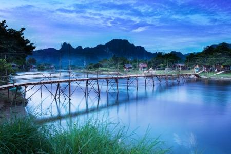 Photo pour Country bridge across Nam Song river, Vang Vieng, Laos  Vang Vieng is a tourism-oriented riverside town and backpacker s paradise in Vientiane Province   - image libre de droit
