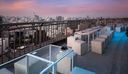 Table   chairs at terrace, urban city skyline, Bangkok, Thailand   - Bangkok is the capital city of Thailand and the most populous city in the country