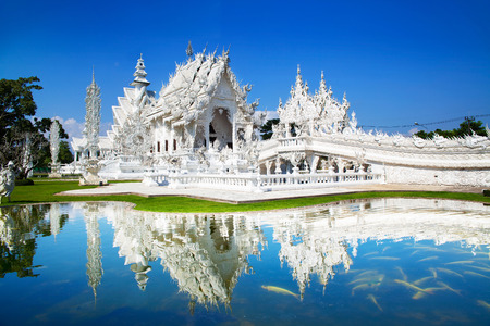 Wat Rong Khun or White Temple, Landmark in Chiang Rai, Thailand. -This is a contemporary unconventional Buddhist temple.