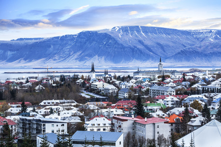 Beautiful aerial view of Reykjavik city, Iceland. with harbor and skyline mountains, seen from the Perlan The Pearl