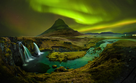 Aurora at Kirkjufell and Waterfall Kirkjufellsfoss, Landmark of Iceland. Kirkjufell Church mountain is mountain on the north coast of Iceland's Snfellsnes peninsula.