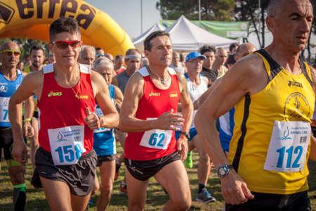 Foto de ALBARELLA, ITALY 10 MARCH 2020: Marathon competition on the island of Albarella in Italy - Imagen libre de derechos