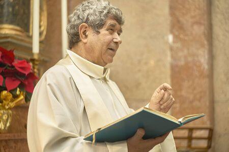 Photo pour Priest celebrates the liturgy in a Catholic church in Italy - image libre de droit