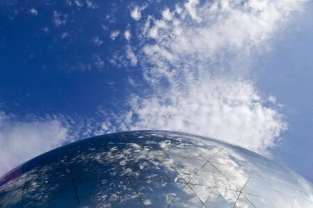 reflection of the sky in a glass dome