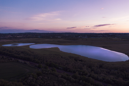 Photo for Aerial shot of Sunset over Waverley Lake, Rotherham, South Yorkshire - Royalty Free Image