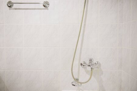 Photo pour Steel hanging shower in a white marble bathroom close-up - image libre de droit
