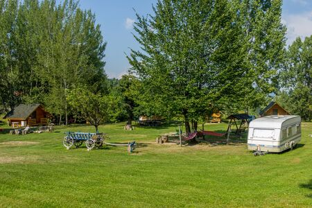 Typical european camping with  bungalows and caravans to rent