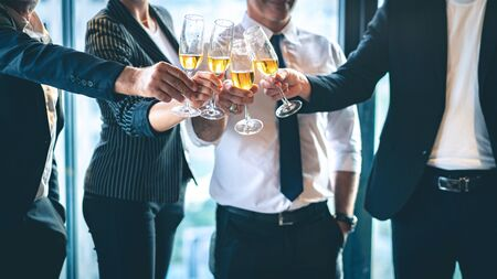 Photo pour Group of business people toasting champagne glasses for the celebration of successful business. - image libre de droit