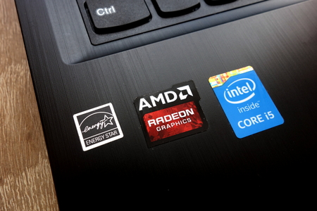Photo pour KONSKIE, POLAND - MAY 06, 2018: Personal computer with stickers: Energy Star, AMD Radeon Graphics and Intel Core i5 - image libre de droit