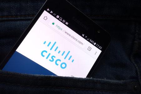 KONSKIE, POLAND - MAY 16, 2018: Cisco website displayed on Samsung smartphone hidden in jeans pocket