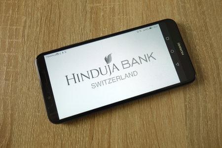 KONSKIE, POLAND - March 16, 2019: Hinduja Bank Switzerland Ltd logo displayed on smartphone