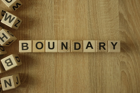 Boundary word from wooden blocks on desk