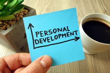 Photo pour Personal development concept with text handwritten on blue sticky note - image libre de droit