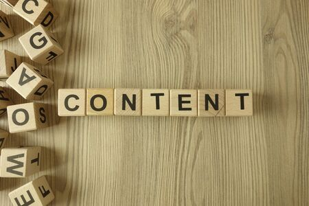 Photo for Word content from wooden blocks on desk - Royalty Free Image