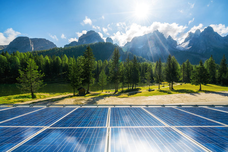 Photo pour Solar cell panel in country landscape against sunny sky and mountain backgrounds. Solar power is the innovation for sustainability of world energy. Sustainable resources. - image libre de droit