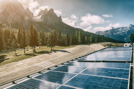 Photo for Solar cell panel in country landscape against sunny sky and mountain backgrounds. Solar power is the innovation for sustainability of world energy. Sustainable resources. - Royalty Free Image