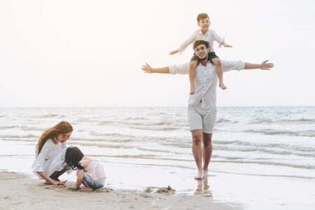 Foto für Happy family of father, mother and kids goes vacation on a tropical sand beach in summer. - Lizenzfreies Bild