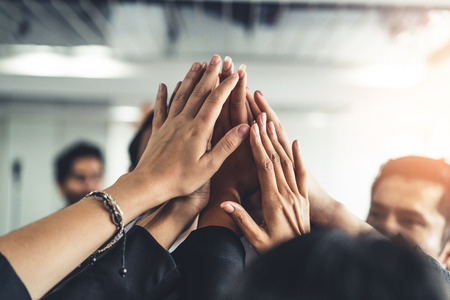 Photo pour Many happy business people raise hands together with joy and success. Company employee celebrate after finishing successful work project. Corporate partnership and achievement concept. - image libre de droit