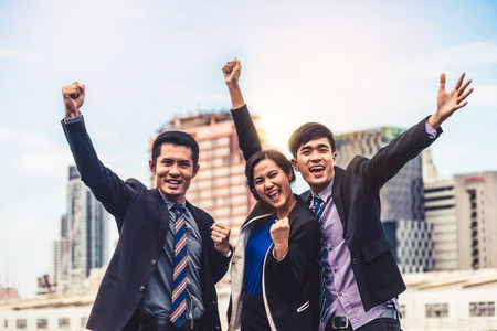 Foto de Happy businessmen and businesswoman celebrate success in project task achievement. Concept of business winner and victory. - Imagen libre de derechos