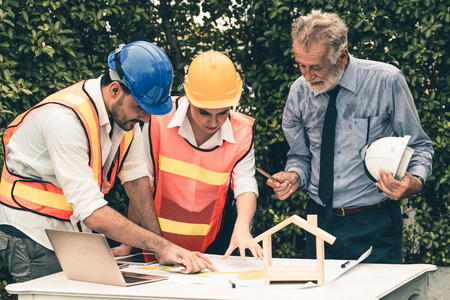 Photo pour Engineer, architect and business man working on the engineering project at construction site. House building concept. - image libre de droit