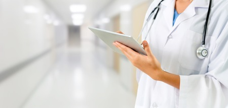 Photo pour Doctor using tablet computer at the hospital. Medical healthcare and doctor staff service. - image libre de droit