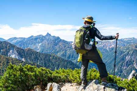Photo pour Epic adventure of hiker do trekking activity in mountain of Northern Japan Alps, Nagano, Japan, with panoramic nature mountain range landscape. Motivation leisure sport and discovery travel concept. - image libre de droit