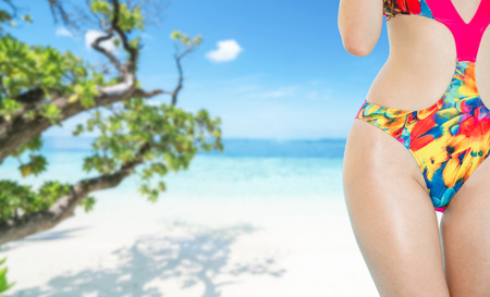 Photo pour Happy young woman wearing swimsuit at tropical sand beach resort in summer for holiday travel vacation. - image libre de droit