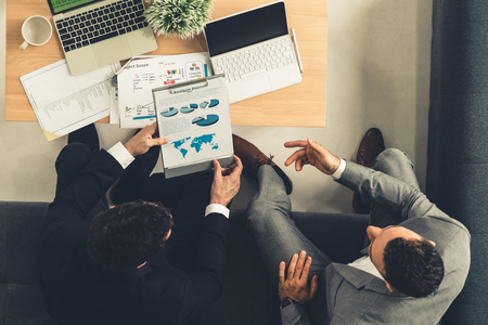 Photo pour Businessman is in meeting discussion with another businessman partner in modern workplace office. People corporate business team concept. - image libre de droit