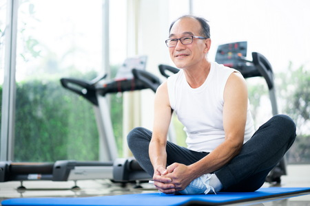 Foto de Senior man do body stretching in fitness center. Healthy lifestyle. - Imagen libre de derechos