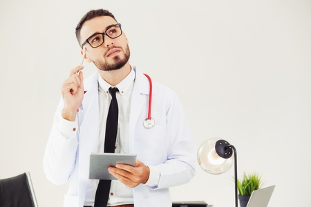 Photo for Doctor working on tablet computer at office in the hospital. Medical and healthcare concept. - Royalty Free Image