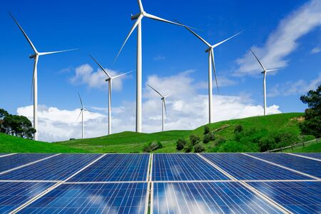 Photo for Solar energy panel photovoltaic cell and wind turbine farm power generator in nature landscape for production of renewable green energy is friendly industry. Clean sustainable development concept. - Royalty Free Image