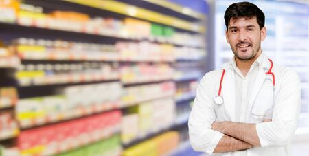 Photo pour Young male pharmacist working at the pharmacy. Medical healthcare and pharmaceutical service. - image libre de droit
