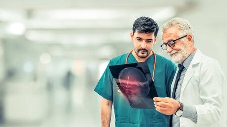 Photo pour Doctors at hospital working with another doctor. Healthcare and medical people services concept. - image libre de droit