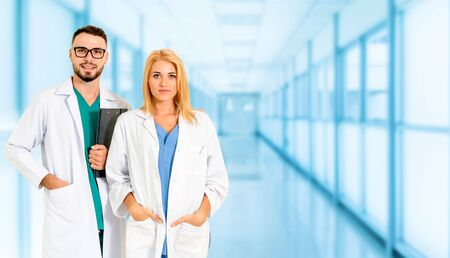 Photo pour Doctor working with another doctor in the hospital. Healthcare and medical service. - image libre de droit