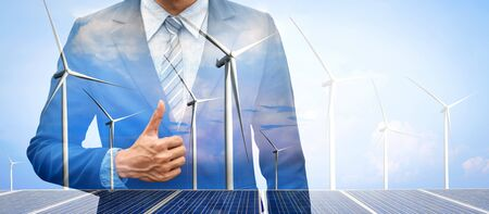 Photo for Double exposure graphic of business people working over wind turbine farm and green renewable energy worker interface. Concept of sustainability development by alternative energy. - Royalty Free Image