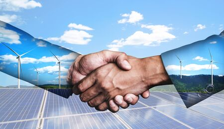 Photo for Double exposure graphic of business people handshake over wind turbine farm and green renewable energy worker interface. Concept of sustainability development by alternative energy. - Royalty Free Image