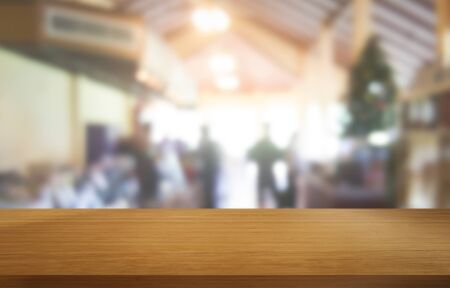 Photo for Wood table in blurry background of modern restaurant room or coffee shop with empty copy space on the table for product display mockup. Interior restaurant counter design concept. - Royalty Free Image