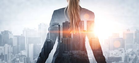 Photo pour Double Exposure Image of Business Person on modern city background. Future business and communication technology concept. Surreal futuristic cityscape and abstract multiple exposure graphic interface. - image libre de droit