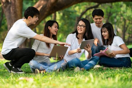 Photo pour Team of young students studying in a group project in the park of university or school. Happy learning, community teamwork and youth friendship concept. - image libre de droit