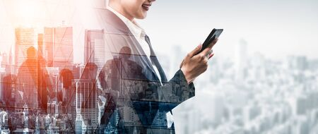 Photo pour Double Exposure Image of Business Communication Network Technology Concept - Business people using smartphone or mobile phone device on modern cityscape background. - image libre de droit