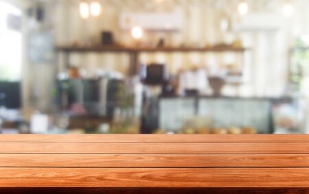 Photo pour Wood table in blurry background of modern restaurant room or coffee shop with empty copy space on the table for product display mockup. Interior restaurant counter design concept. - image libre de droit