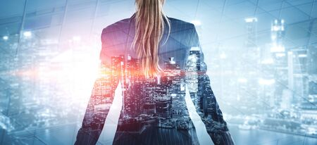 Foto de Double Exposure Image of Business Person on modern city background. Future business and communication technology concept. Surreal futuristic cityscape and abstract multiple exposure graphic interface. - Imagen libre de derechos