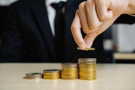 Foto de Businessman working with coin money currency. Concept of investment growth and money saving. - Imagen libre de derechos