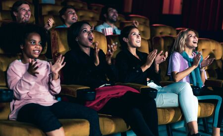 Photo for People audience watching movie in the movie theater cinema. Group recreation activity and entertainment concept. - Royalty Free Image