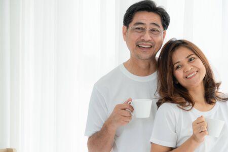 Photo pour Happy Asian senior couple having good time at home. Old people retirement and healthy citizens elderly concept. - image libre de droit