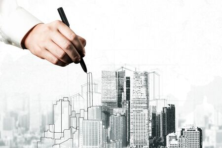 Photo pour City civil planning and real estate development - Architect people looking at abstract city sketch drawing to design creative future city building. Architecture dream and ambition concept. - image libre de droit