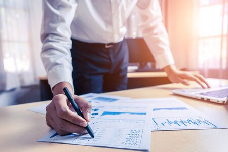 Photo pour Businessman accountant or financial expert analyze business report graph and finance chart at corporate office. Concept of finance economy, banking business and stock market research. - image libre de droit