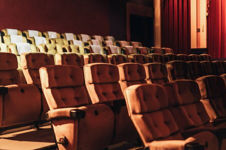 Photo pour A row of yellow seat with popcorn on chair in the movie theater - image libre de droit